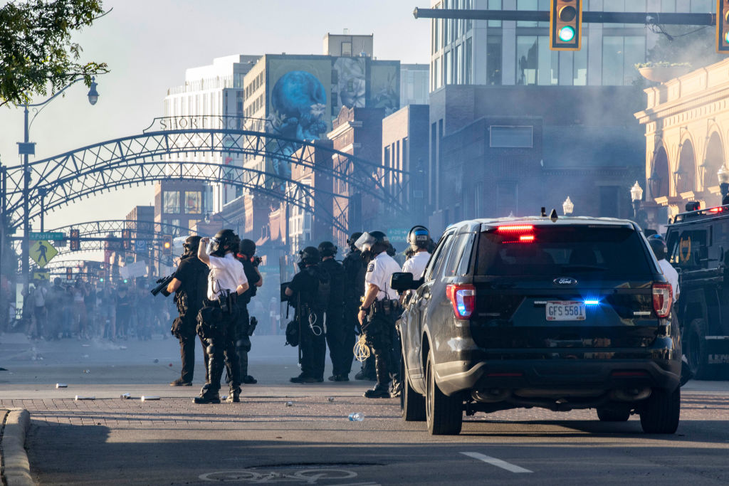 Columbus Police and SWAT officers fire tear gas canisters to...