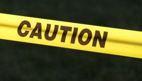 Caution sign: Caution sign tape against black background...