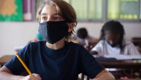 Pupils doing classwork at classroom. Covid-19 Concepts