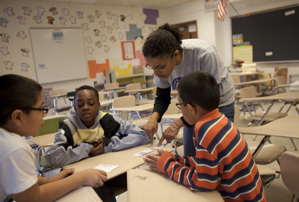 Students study during the George B. Thomas Learning Academy Saturday School at Wheaton High School in Silver Spring.